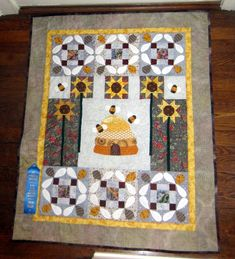 Bee quilt that I made for my grandson.  It's my own design - I took elements from other quilts I found and put them together into this.