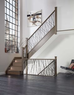 A true statement staircase, this contemporary steel design brings century style to the room. The unique balustrade design has been constructed out of strong steel spindles set into a solid wood base for a modern, eye-catching result. Staircase Metal, Luxury Staircase, Staircase Railings, Banisters, Metal Stair Spindles, Stair Handrail, Staircase Ideas, Staircases, Balustrade Design