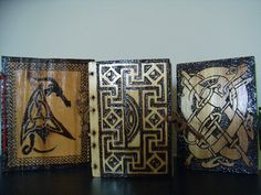 Hand made, hand bound, pyrographed notebooks.