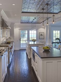 Open, white kitchen