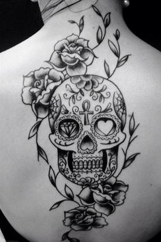 Black sugar skull with roses tattoo on back