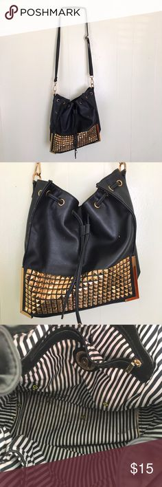 Nila Anthony Black Studded Purse Some used stains inside. And the corner edge of the purse is broken. You can use Crazy glue or hot glue to fix that up. Overall its a fair condition. Nila Anthony Bags Shoulder Bags
