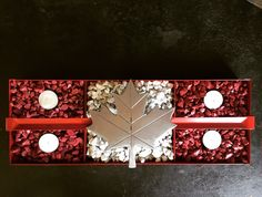 Made this with a unused tool box tray, stones from my driveway and hand cut the Canadian leaf..