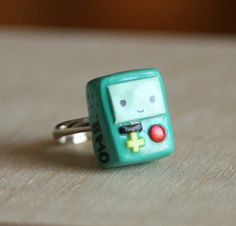 Hey, I found this really awesome Etsy listing at http://www.etsy.com/listing/158866817/adventure-time-bmo-beemo-polymer-clay