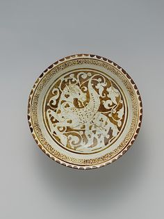 Luster Bowl with Winged Horse    Object Name:      Bowl  Date:      late 12th century  Geography:      Iran  Medium:      Stonepaste; luster-painted on opaque monochrome glaze  Dimensions:      H. 3 1/4 in (8.3 cm) Diam. 8 in. (20.3 cm)  Classification:      Ceramics