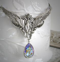 THE GUARDIAN romantic vintage fantasy inspired angel necklace with large Swarovski crystal, free gift boxing. via Etsy.