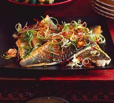 Sea bass with sizzled ginger, chilli & spring onions