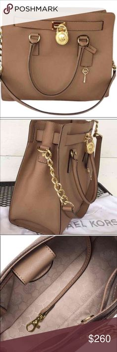 "Authentic Michael kors shoulder bag Authentic Michael Kors Hamilton saffiano satchel dark dune!( Tan color) size large! Like new condition! Very clean! No damages! Used two times! Measurement: 12.5"" W 9"" H 5.5"" D Michael Kors Bags Shoulder Bags"