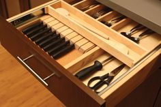 The slotted knife holder from Dura Supreme Cabinetry can be hidden below a two-tier cutlery tray for maximum drawer use.