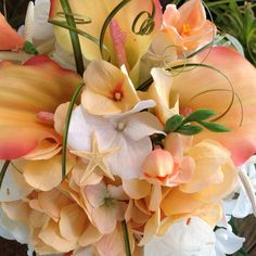 Peachy Coral Bridal Bouquet with Hydrangeas Starfish and Freesias with Sand Dollars and Bear Grass