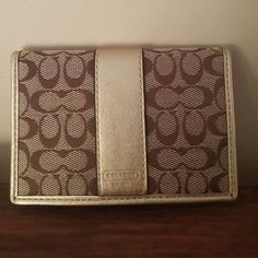 Authentic Coach mini wallet or ID case Gold and Brown Coach mini wallet or ID case.   Never used. Received as gift. Coach Bags Wallets