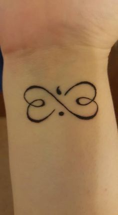 Wrist Tattoo With Incredible Meaning: Semicolon - suicide awareness. Infinity Sign - life goes on. Two Hearts - love & support. Looks like a butterfly to represent hope & change. By Brittany Marie #tattoo #WristTattoo #SuicideAwareness