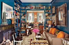 Blues! & obelisks on the mantel! Home Library Bookshelf Design Photos | Architectural Digest