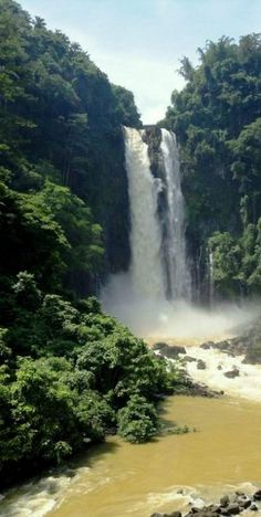 """Waterfall of the Agus River on the island of Mindanao. Sometimes called the """"twin falls"""" as the flow is separated by a rock at the brink of the waterfall. It is a landmark of Iligan City, nicknamed the City of Majestic Waterfalls."""