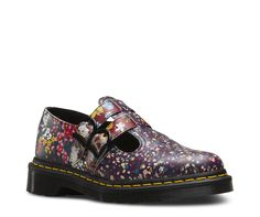 $125__  Our iconic Mary Jane 8065 features two buckled straps, but now with our new Floral Clash print, three prints brought together in a riotous mashup printed all over the shoe. This version of the 8065 shoe is a refined update to the traditional silhouette, but retains all the classic Doc DNA, like grooved sides, yellow stitching and the traditional Dr. Martens air-cushioned, Goodyear-welted sole.