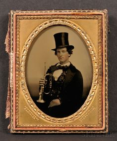 """Quarter Plate Portrait of a Young Man Seated, with a Bugle, the brass mat impressed """"AMBROTYPE BY E.S. BUTLER,"""" a label on the case is inscribed """"Taken July 14, 1858,"""""""