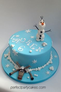 Disney's Frozen cake. Olaf and Sven the reindeer having fun in the snow.