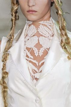 Alexander McQueen spring 2011 ready-to-wear details.  Nice, although not for fresh mummy :)