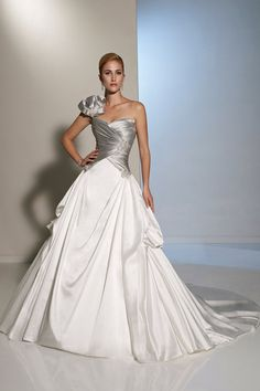 A vision to behold Primalia is a stunning one-shoulder ball gown in Paris satin and Mikado with a sculpted sweetheart neckline. Wedding dress gown Silver and white gown