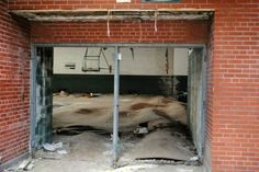 East Catholic High School, Detroit, MI. That's not sand or dirt, it's the warped floor (water damage from the elements)