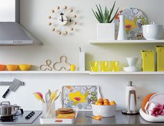 Sprinkle in a vibrant touch of color, in the form of accessories and small appliances, to liven up the space's aesthetic.