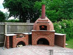 this is a little too much brick, but great chimney, wall, stone or concrete shelving, arches repeated, grill area.