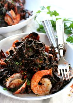 """Arrabiata Squid Ink Pasta which literally translates to """"Angry"""" Squid Ink Pasta, but is far from angry, and oh so delicious. Squid Ink Spaghetti, Squid Ink Pasta, Squid Recipes, Seafood Pasta Recipes, Fettuccine Recipes, Pasta Restaurants, Restaurant Recipes, Restaurant Design, Fish And Seafood"""