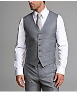 How great is the waistcoat look on a guy? Slimming middle, refined shoulders, and in my opinion, looks best with messy hair and the sleeves rolled up a bit. Delicious!