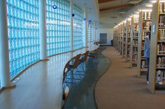 """""""Library Interior,"""" by webmaster, via Flickr -- """"The [San Diego] College-Rolando Library offers free wireless Internet access, ample space and light and community space including a fireplace and an outdoor patio."""""""