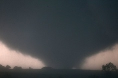 A tornado touches down near El Reno, Okla., Friday, May 31, 2013, causing damage to structures and injuring travelers on Interstate 40. I-40 has been closed after severe weather rolled through the area   Our prayers are with OK.