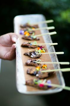 Beef Skewer with Edible Flower  Photography: Mi Belle Photographers Read More: http://www.insideweddings.com/weddings/colorful-outdoor-wedding-with-supper-club-theme-in-los-angeles-ca/741/