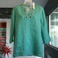 Chic and classy top (nwt) Stunning top in a dusty turquoise color with silver metal details around neck. (Upclose pic #4) Grab this beauty for your weekend trip, or day at the beach! This top offers comfort while still be classy and chic! Crop Approximately 3/4 length sleeves.  Side slits (seen in pic#2 New with tag Size:small, loose fitting 100%linen Color on tag: dusty turquoise August Silk Tops