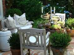 A wonderful seating area on the open terrace just off the covered back porch. Succulents in pots are low maintenance and in our zone 8b Gulf Coastal gardens with the ample rainfall they rarely needed watering ~