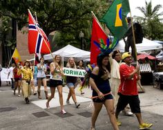 HPU students parade through downtown while representing their home countries. Photo by Chris Aguinaldo.