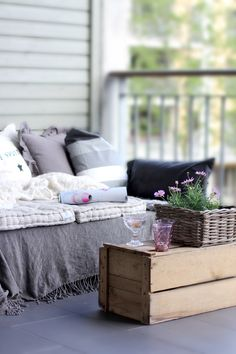 There are LOTS of DIY pallet projects out there, but this one is my fave. Why? Because you can't see the dang pallets. Let's face it: they're ugly, people! Nina at Stylizmo just stacked two and added throws and pillows. Easy peasy.