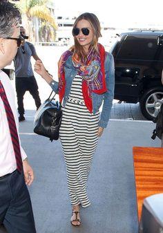 Miranda Kerr in a striped dress and denim jacket