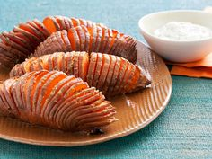 Hasselback Sweet Potatoes : Hasselback potatoes are whole potatoes that have been cut into a fan shape, dotted with butter, then roasted. The result is a crispy-on-the-outside, creamy-on-the-inside spud. The technique can be done with white or sweet potatoes.