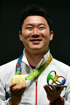 #RIO2016 Gold medal winner South Korea's Jin Jongoh celebrates on the podium during the medal ceremony for the 50m Pistol Men's Finals shooting event at the...