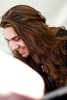 Chris Rörland of Sabaton. I love his hair so much *-*