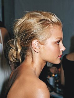 The trick to making an updo sexy? Give it some rumpled texture. Use your fingers instead of a comb to rake back your hair so it's not tight against your head.