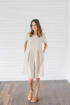 Tan Modest Dress from Bella Ella Boutique    Bella Ella Boutique. Womens Online Clothing Boutique. Tan Dress. Pockets. Sleeves. Pleats. Pleated Tan Dress. Womens Modest Clothing Boutique. Modest Dresses. Modest Dresses for Spring.