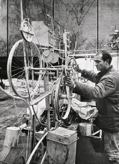 Jean Tinguely at work on Homage to New York (1960)