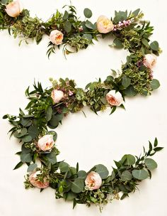 STEP 3 Fill in any holes by wrapping the extra flowers you saved on to your garland. Then you're done!