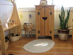 A play space by Amy Wonder Years, via Flickr - Love that little cabinet