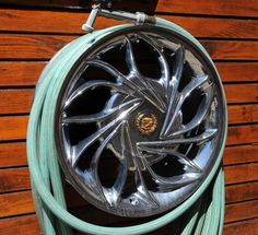 Cool idea for a garden hose holder. In today's Detroit News story: Hot rod heaven #cadillac #hotrod #rims  Should have saved one of mine when the pot hole destroyed the rim.