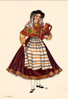OLIVA - Saia escura com barra. Avental e blusa de chita. Lenço de cores vivas…