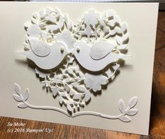 handmade love/Valentine card ... white on white ... lacy die cut heart with pair of punched birds ... Stampin' Up!
