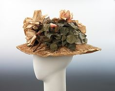 The mixing of materials was an important design feature in fashions of the 1900s, and the milliner of this hat has accordingly demonstrated her inventiveness and sensitivity to current trends by overlaying the straw with lace, a material which was also a prevalent element of contemporary clothing. While retaining a feminine air, the hat is given a boldness characteristic of the period by the use of a fairly coarse lace and by the large and abundant flowers trimming the oversize crown. The…