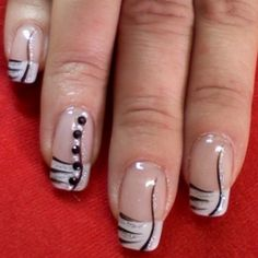 black and white design with stone accents nail art