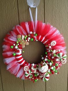 Christmas candy tulle wreath--would do solid red or green tulleChristmas Candy Tulle Wreath - no instructions but easy enough to do.Adorable Christmas Wreath Ideas For Your Front Door of thanksgiving tulle wreathsMagnificent DIY tulle wreath Tulle Crafts, Wreath Crafts, Diy Wreath, Christmas Projects, Holiday Crafts, Wreath Ideas, Tulle Wreath Tutorial, Christmas Crafts For Gifts For Adults, Christmas Candy Crafts